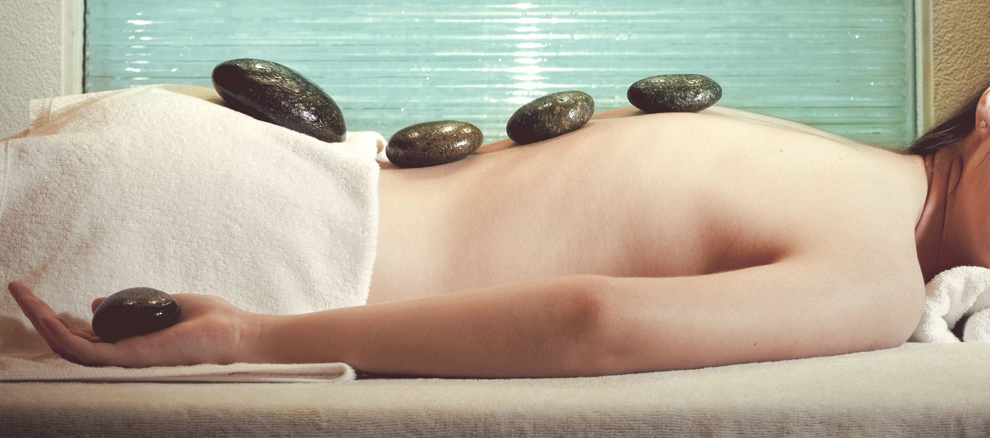 Enjoy our Heat Wave package- Get a relaxing hot stone massage (90 minutes)